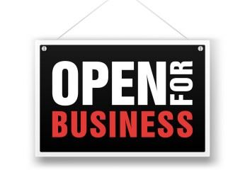 Hanging sign saying open for business
